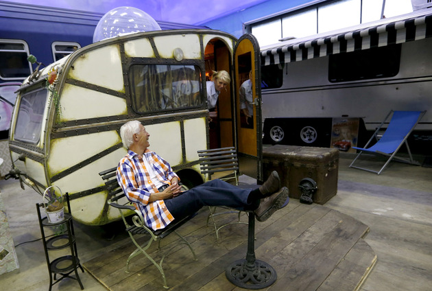 An-elderly-couple-explores-a-vintage-camping-caravan--at-the-Base-Camp-Bonn-Young-Hostel-in-Bonn_138147838347217