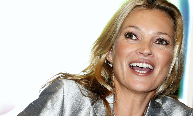 Model-Kate-Moss-laughs-as-she-attends-a-media-viewing-for-the-forthcoming-sale-A-Celebration-of-Kate-Moss-at-Christies-auction-house-in-London_1382002160659538