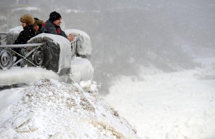 Visitors observe Niagara Falls, Ontario